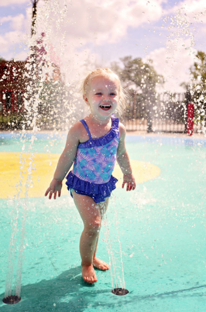 girl in splash pad